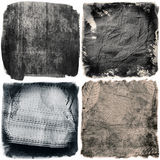 Grunge dark textures. Four grunge dark textures for your next project royalty free stock images