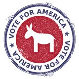 Grunge democrat donkeys rubber stamp. USA presidential election patriotic seal with democrat donkeys silhouette and Vote For America text. Rubber stamp vector Royalty Free Stock Photos