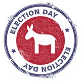 Grunge democrat donkeys rubber stamp. USA presidential election patriotic seal with democrat donkeys silhouette and Election Day text. Rubber stamp vector Royalty Free Stock Image