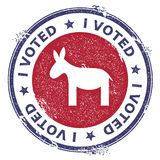 Grunge democrat donkeys rubber stamp. USA presidential election patriotic seal with democrat donkeys silhouette and I voted text. Rubber stamp vector Royalty Free Stock Images