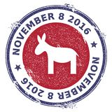 Grunge democrat donkeys rubber stamp. USA presidential election patriotic seal with democrat donkeys silhouette and November 8, 2016 text. Rubber stamp vector Stock Images
