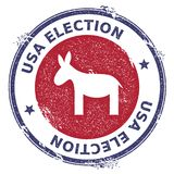 Grunge democrat donkeys rubber stamp. USA presidential election patriotic seal with democrat donkeys silhouette and USA Election text. Rubber stamp vector Royalty Free Stock Photography
