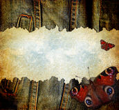 Grunge denim wallpaper. Worn grunge denim texture ripped on a light blue sky texture with flying butterflies royalty free illustration