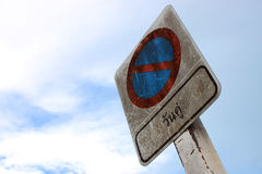 Grunge and dirty traffic sign against the sky Royalty Free Stock Image