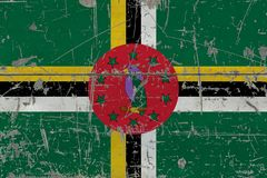 Grunge Dominica flag on old scratched wooden surface. National vintage background.  stock photos