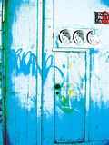 Grunge Door Background. Blue coloured doorway with grafitti and torn posters royalty free illustration