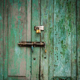 Grunge door green double lock Stock Photo