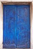 Grunge door painted in blue Stock Images