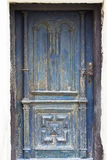 Grunge door painted in blue worn and weathered Royalty Free Stock Photography