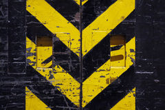 Grunge door - yellow and black stripes Royalty Free Stock Image