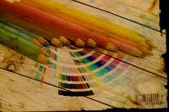 Grunge Drawing tools. Multicolor drawing pencils and color guide over grunge abstract background Stock Photo