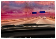 Grunge driving into the storm. Illustration of a South-African highway in a coming storm shot from the passenger?s seat Royalty Free Stock Images