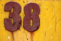 Grunge du numéro 38 sur le jaune Images libres de droits
