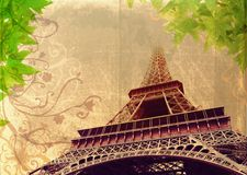 Grunge Eiffel Tower in sepia. Eiffel Tower in high contrast sepia - France, Paris, on grunge background with swirls and scrolls Stock Photos