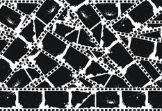 Grunge Empty filmstrips background. Grunge chaotic  filmstrips background (black and white Royalty Free Stock Images