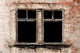 Grunge empty windows on old brick wall Stock Photos