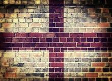 Grunge England flag on a brick wall Stock Photo