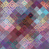 Grunge ethnic pattern on blur background. Royalty Free Stock Photos