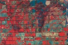 Grunge färgade den röda blåa väggen, pantonen, cement, tegelstenar Arkivbilder