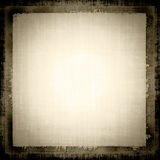 Grunge Fabric. Vintage old linen brown tones grunge canvas texture fabric with a darker border for background designs Stock Photo