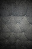Grunge Fabric Texture. Full frame gray grunge texture background, gray fabric cushion with buttons Royalty Free Stock Images