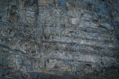 Grunge fantastic gray-blue stone wall with uneven hollowed-out surface. Close-yp grunge fantastic gray-blue stone wall with uneven hollowed-out surface Royalty Free Stock Photos