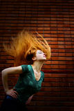 Grunge fashion shot of woman with motion hair. Grunge fashion portrait of woman with motion hair Royalty Free Stock Image
