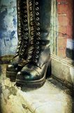 Grunge female lace-up boots Stock Photography