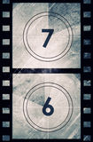 Grunge film countdown. In dark color Stock Photography