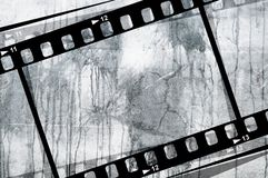 Grunge Film frame. A grunge film reel background Royalty Free Stock Photos