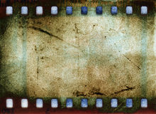 Grunge Film Frame. Over aged paper background royalty free illustration