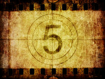 Grunge Film Negative Background Countdown Leader. A distressed grunge background texture of an old slice of film negative with film leader countdown Royalty Free Stock Photography