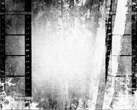 Grunge Film Strip Background. Black and white grunge texture background with film strips border and copy space Stock Photos