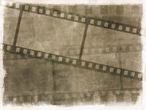 Grunge film strip background. Dirty grunge background with image of film strips Stock Photo