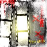 Grunge film strip background. And written Royalty Free Stock Photos
