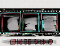Grunge film strip with doodle multimedia control elements. Doodle grunge film strip with doodle multimedia control elements on paper background Stock Photo
