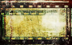 Grunge film strip frame background. Old grunge film strip background Royalty Free Stock Photo