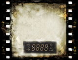 Grunge film strip frame with dvd digital clock Royalty Free Stock Images