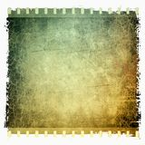 Grunge film strip frame. Green and sepia tones Royalty Free Stock Image