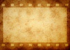 Grunge film stripe. Aged paper texture royalty free stock photos
