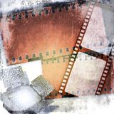 Grunge film strips background with led reflector Royalty Free Stock Images
