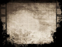 Grunge filmstrip. With some stains Stock Photos