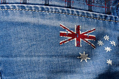 Grunge flag of Australia. Abstract grunge flag of Australia on a blue jeans background stock photo