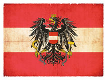 Grunge flag of Austria with Coat of Arms Royalty Free Stock Image