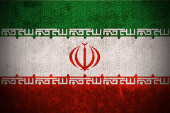 Grunge Flag Of Iran. Weathered Flag Of Iran, fabric textured Stock Image