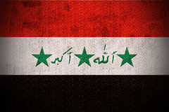 Grunge Flag Of Iraq. Weathered Flag Of Iraq, fabric textured Stock Images