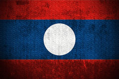 Grunge Flag Of Laos. Weathered Flag Of Laos, fabric textured Stock Image