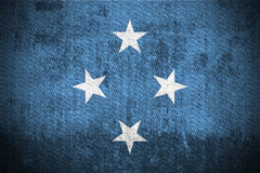 Grunge Flag Of Micronesia. Weathered Flag Of Micronesia, fabric textured Stock Photography