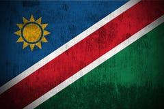 Grunge Flag Of Namibia. Weathered Flag Of Namibia, fabric textured Stock Images
