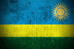 Grunge Flag Of Rwanda. Weathered Flag Of Rwanda, fabric textured Stock Photography